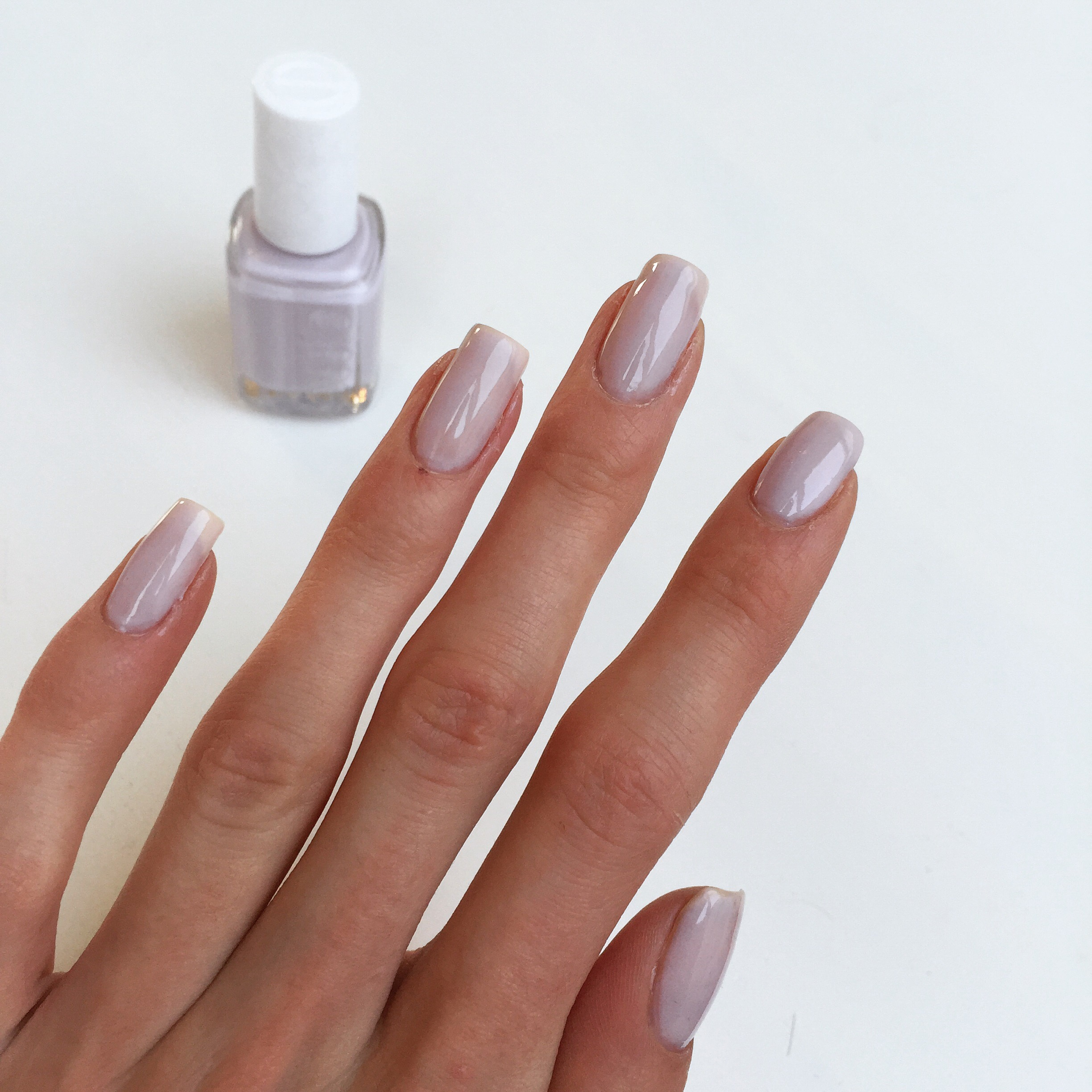 Shiny and glossy, a big advantage of the sheer polishes. Very delicate and  cute. I love it! Completely opaque in three coats, but since it's  non-streaky, ...